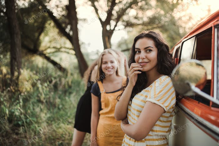 A group of young girl friends on a roadtrip through countryside.