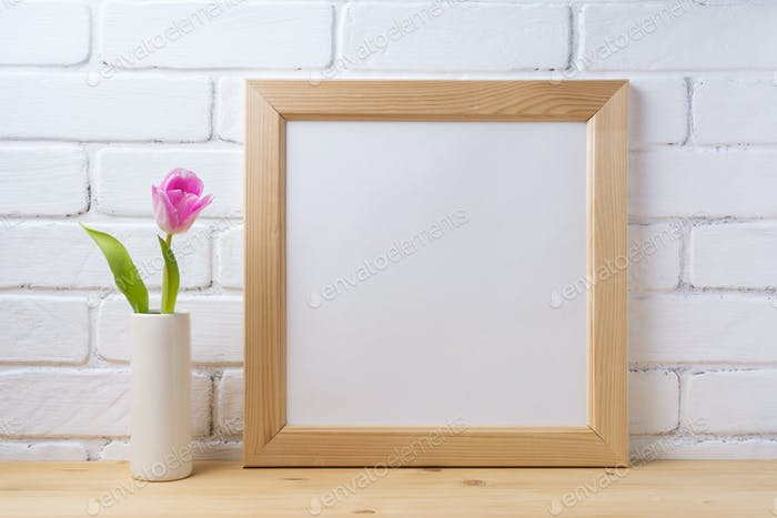 Wooden square frame mockup with pink tulip