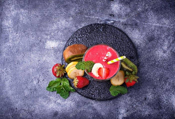 Smoothie with strawberry, banana and kiwi