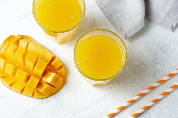 Fresh mango juice on light background