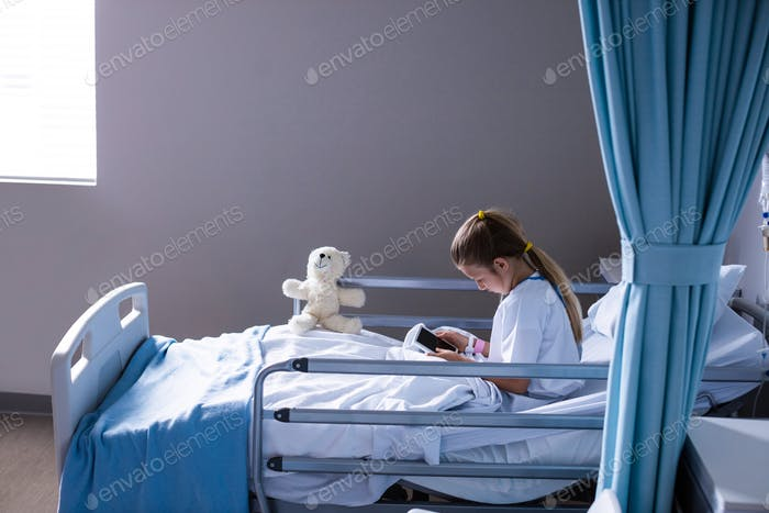 Patient using digital tablet in ward