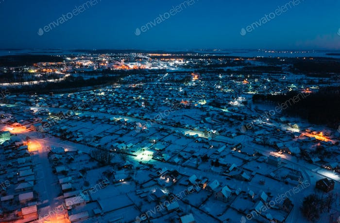 Aerial View Of Town Skyline Winter Night. Snowy Landscape Cityscape Skyline