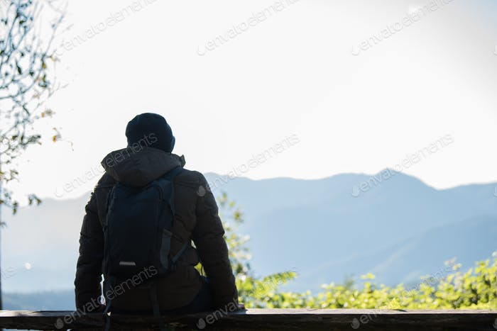 Men traveller going alone in the wild