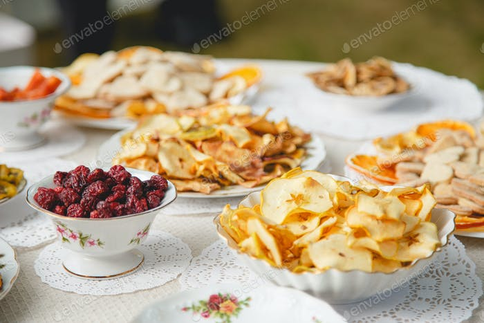 Healthy food: mix from dried fruits in bowl, selective focus