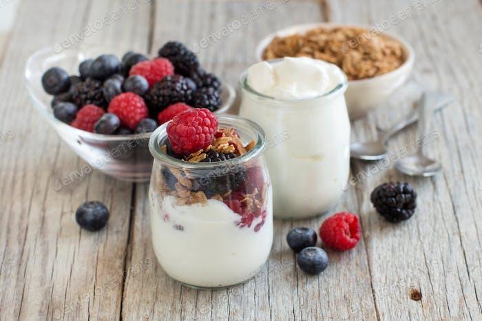 Breakfast with Fresh greek yogurt, muesli and berries