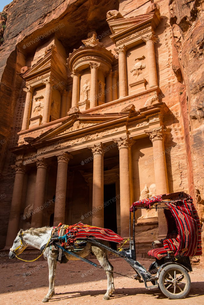 Horse carriage in the front of Treasury. Petra, Jordan. Ancient stone carving