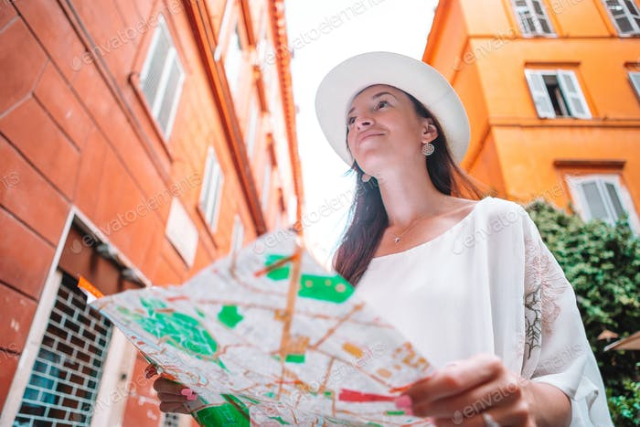 Travel tourist woman with map in Prague outdoors during holidays in Europe