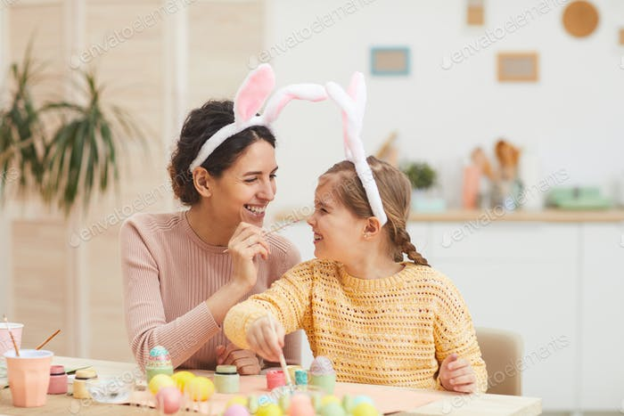 Mother and Daughter Enjoying Easter Preparations