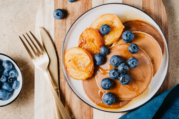 Top view of pancakes with grilled peaches