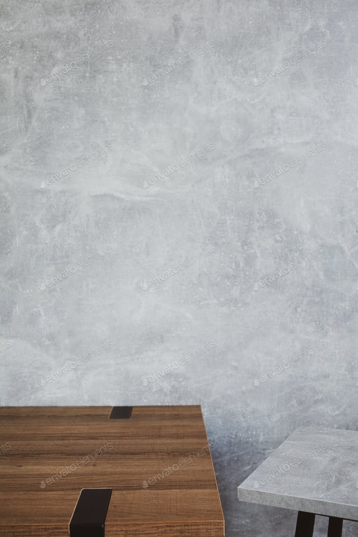 wooden table and stool with grey wall background