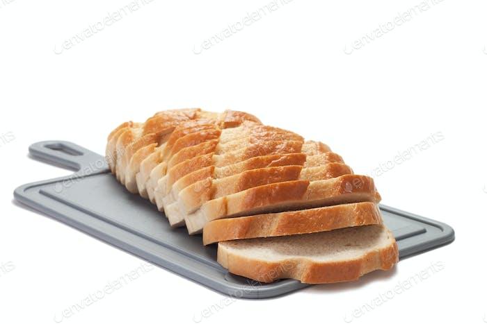 Sliced Bread On Breadboard Isolated