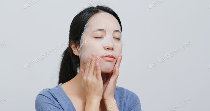 Woman apply face mask