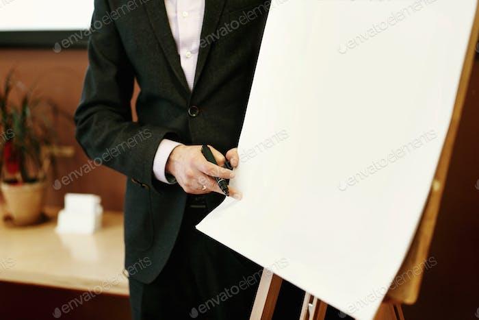 elegant speaker lecturer holding marker at empty white board