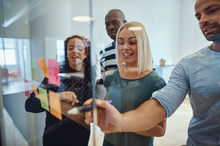 Group of designers smiling during an office brainstorming session