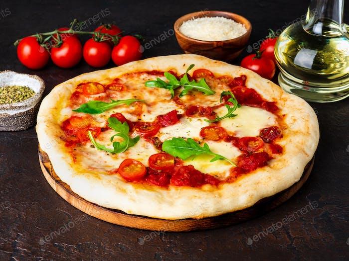 hot homemade Italian pizza margherita with mozzarella and tomatoes