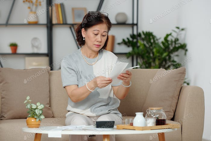 Woman calculating home expenses