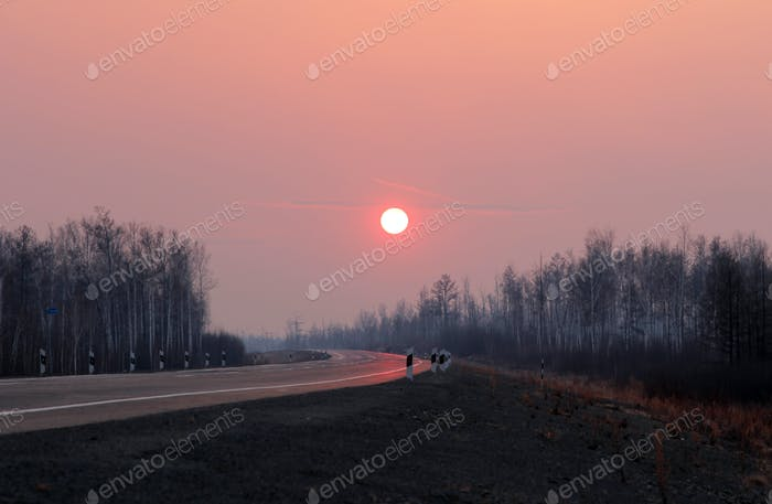 Road to Siberia in winter sunset.