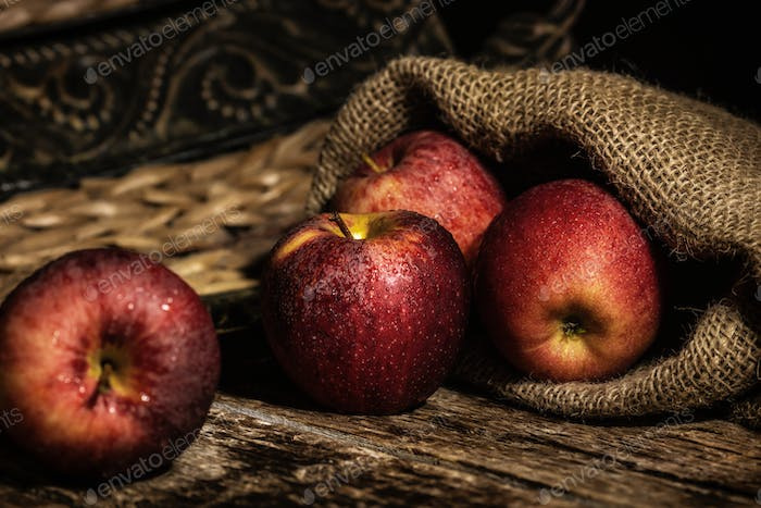 Fresh red apples on wooden rustic table