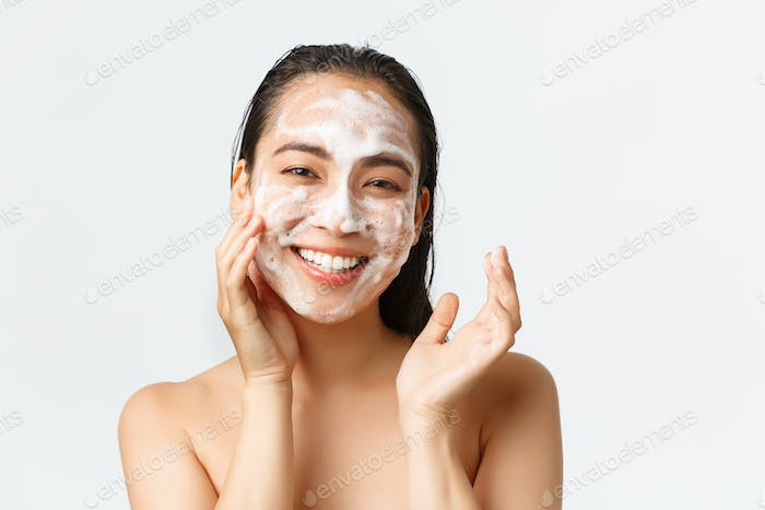 Skincare, women beauty, hygiene and personal care concept. Close-up of happy smiling asian woman