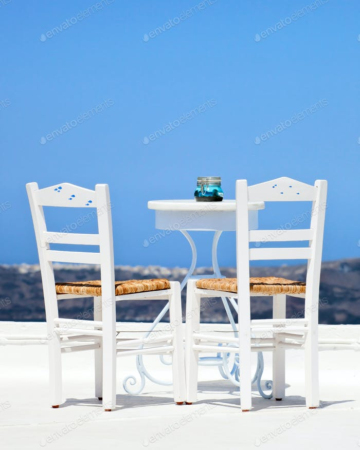 Two white chairs in santorini
