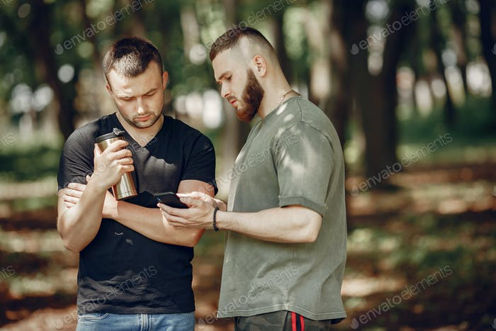 Two friends have a rest in a summer forest