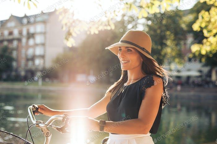 20-30 years; attractive female; beautiful; bicycle; bike; bright
