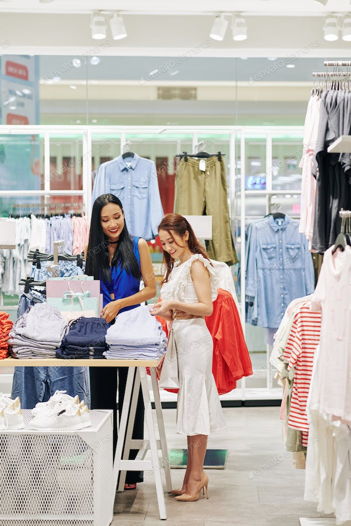 Women choosing clothes in stor