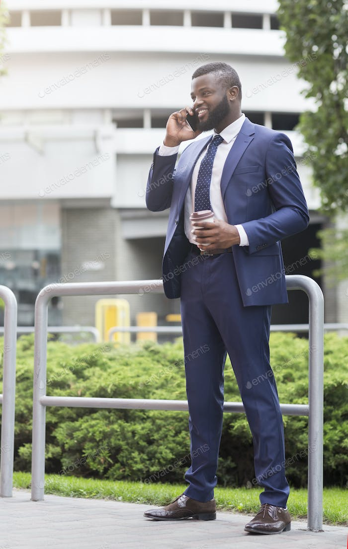African american business person talking on mobile phone outdoors