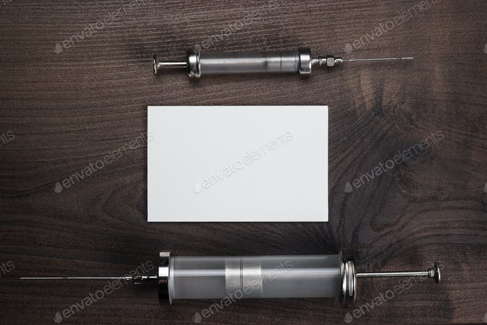 Retro Medical Syringes And Notebook Over Wooden Background