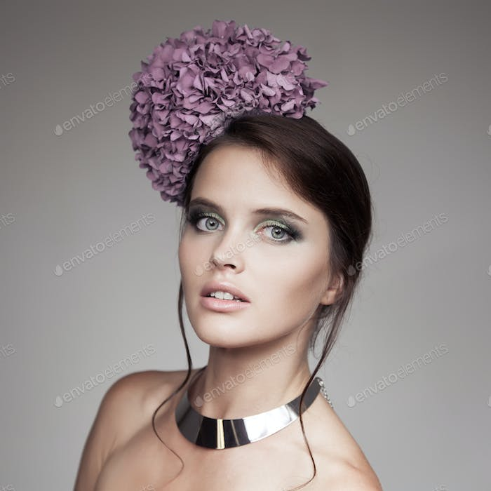 Fashion Portrait Of Beautiful Woman With Blue Flower Hydrangea