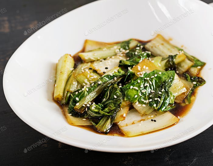 Bok choy vegetables stir fry with soy sauce and sesame seeds. Chinese cuisine.