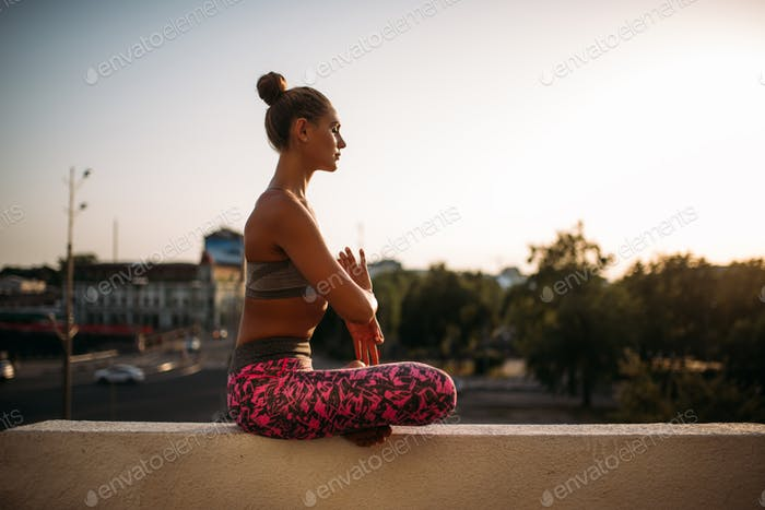 Beautiful young woman relax in yoga pose