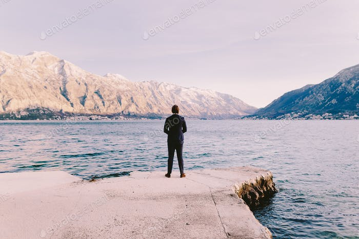 business man looking at mountains