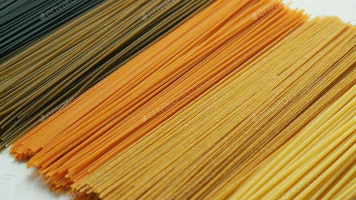 Uncooked pasta in row