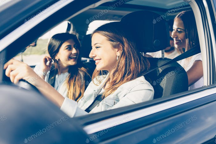 Friends on vacations by car