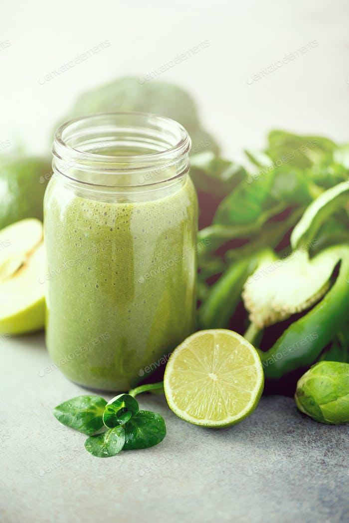 Glass jar mugs with green health smoothie. Copy space. Vegan, vegetarian concept. Alkaline food