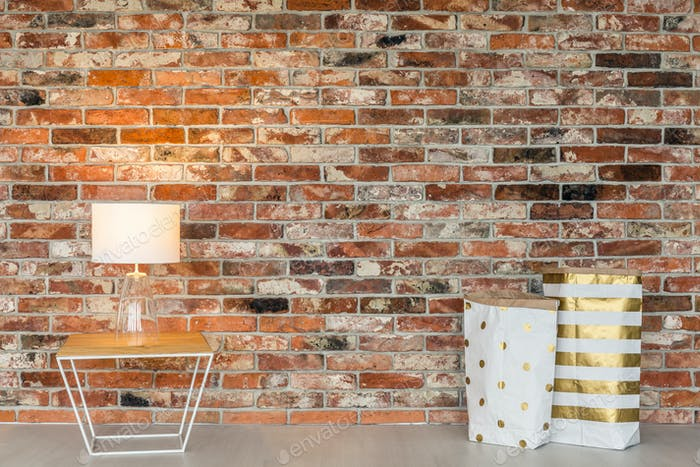 Brick wall and gift bags
