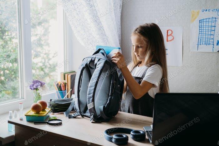 Back to school, schoolchildren hygiene, safety precautions after coronavirus. The schoolgirl is