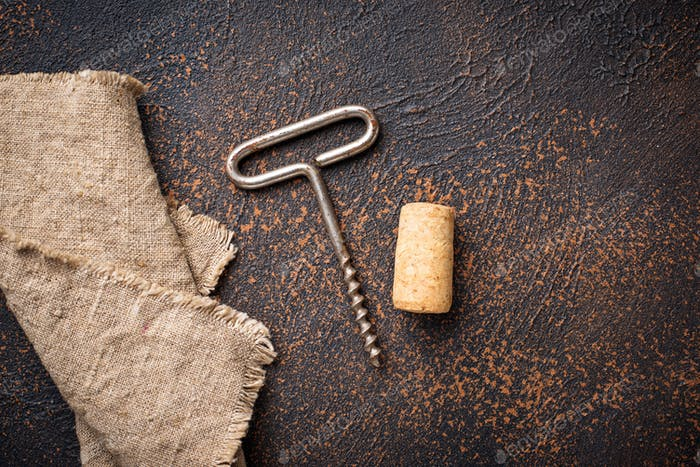 Old vintage corkscrew and wine cork