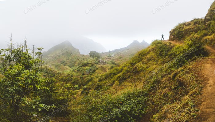 Santo Antao Island, Cape Verde. Traveler tourist hiking on mountain plateau of Paul Valley