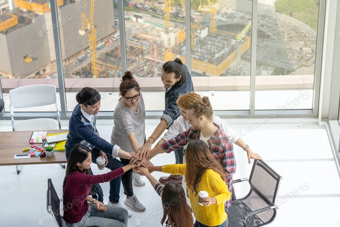 Top view scene of Asian and Multiethnic Business people standing and Hand coordination