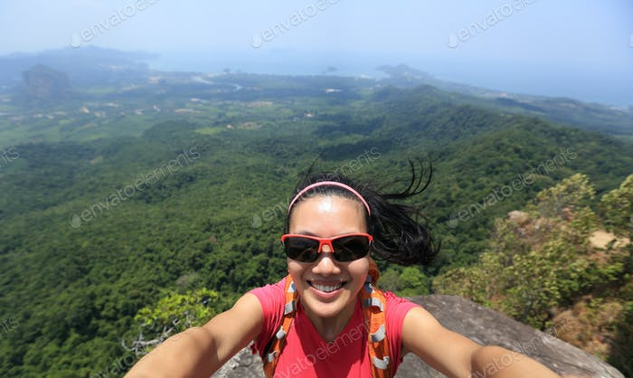 Taking selfie on cliff edge