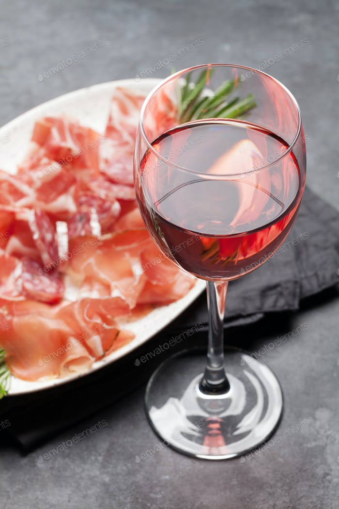 Wine glass and spanish jamon plate