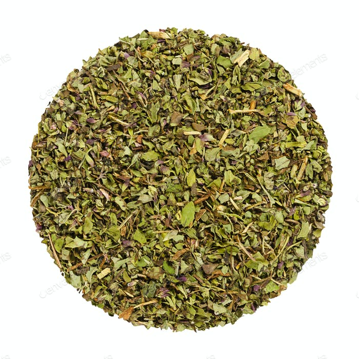 Dried oregano, herb circle from above, over white