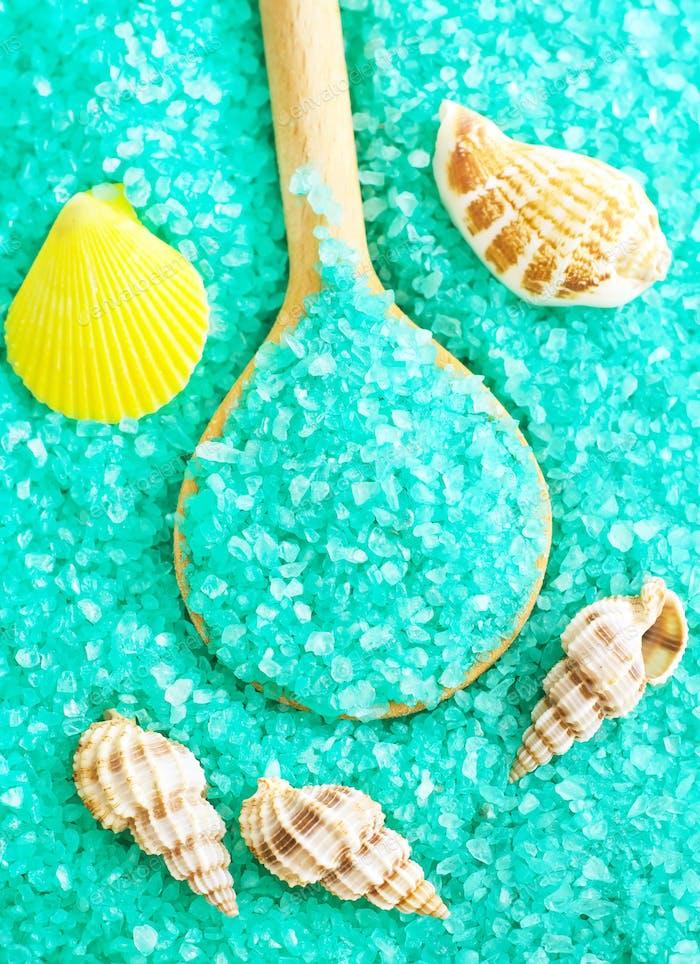 Blue sea salt in wooden spoon, sea salt for spa