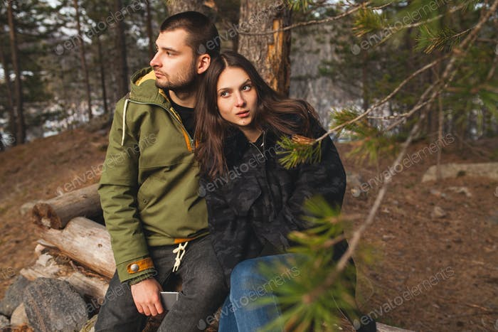 young beautiful hipster couple hiking in mountains