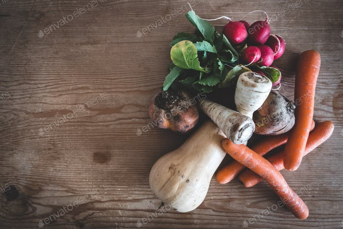Organic root crops and other vegetables on table