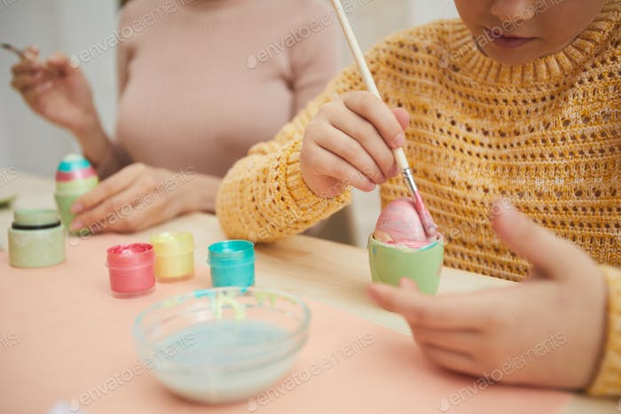 Closeup of Little Girl Painting Easter Eggs