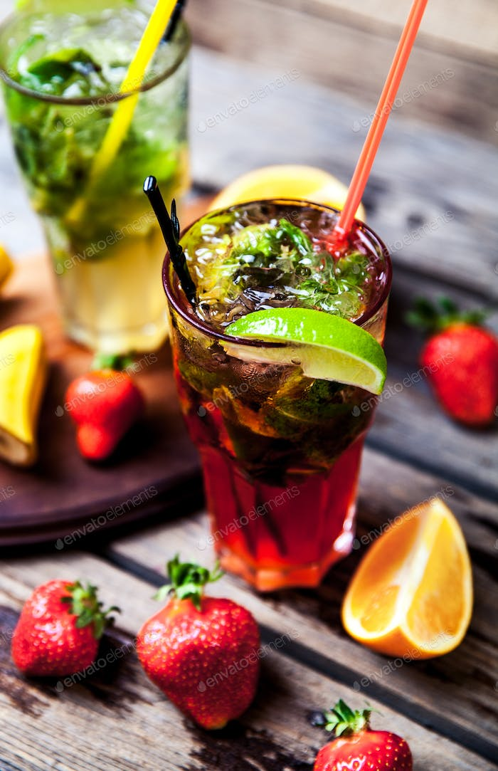 Tradition Summer drink mojito with lime and mint, strawberries