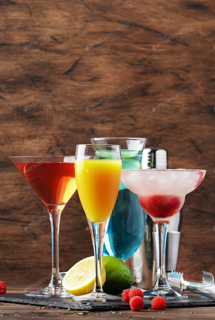 Selection of summer alcoholic cocktails, popular bright refreshing alcohol drinks and beverages